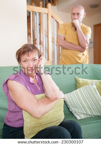 Older woman quarrel with his son.