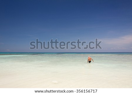 Ole man Tourists relaxing in the blue sea at Tachai  island,Thailand