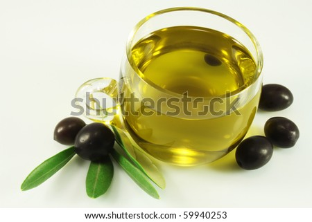 Olive oil, olives, and branch