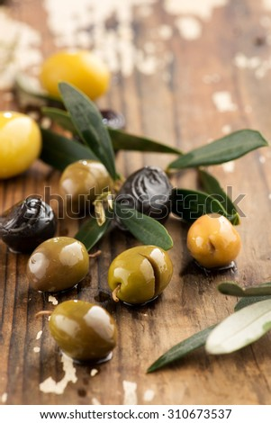 Olives over Wooden Background