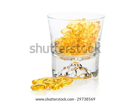 Omega-3 vitamins in glass  on white background