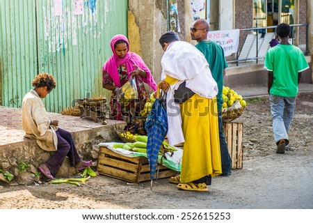 OMO, ETHIOPIA - SEPTEMBER 21, 2011: Unidentified Ethiopian people buy bananas at the market. People in Ethiopia suffer of poverty due to the unstable situation