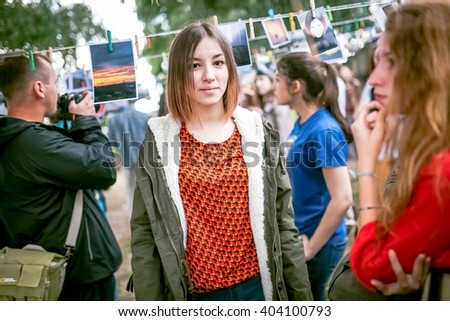 Omsk, Russia - May 21, 2014: Festival of Photography in street, people watching