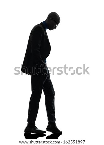 one african  black man standing looking down  in silhouette studio on white background