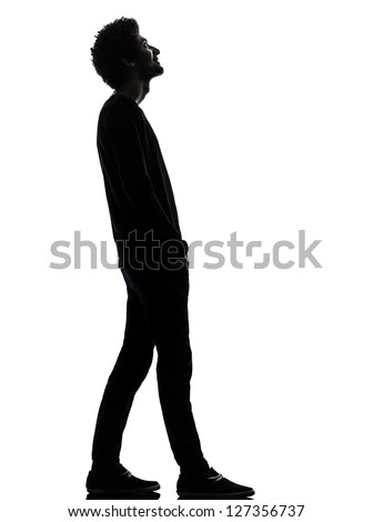 one african handsome young man standing  looking up smiling  in silhouette studio isolated on white background