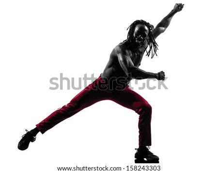 one african man exercising fitness dancing  in silhouette  on white background