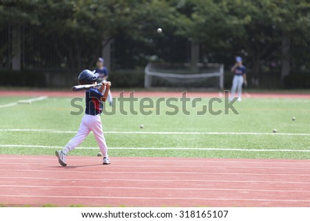 One boy practice the baseball at school yard