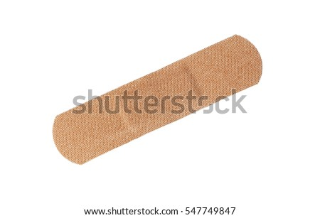 One brown unused fabric plaster isolated on white background.