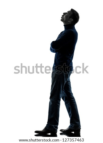 one caucasian man looking up pensive  full length in silhouette studio isolated on white background