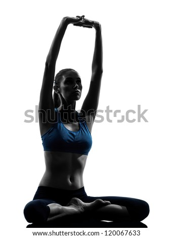 one caucasian woman exercising yoga meditating sitting stretching in silhouette studio isolated on white background