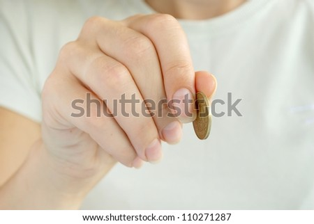 one coin in a hand of the girl