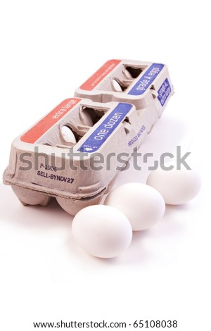 One dozen eggs in a carton isolated on white background with three eggs