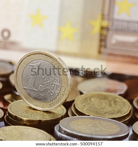 One euro coin on money background