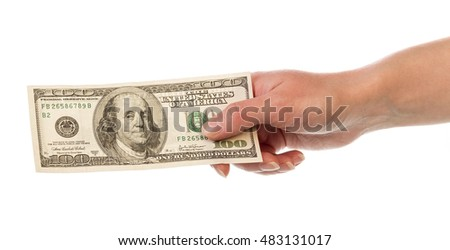 One hundred dollar bill in a female hand isolated on white background.