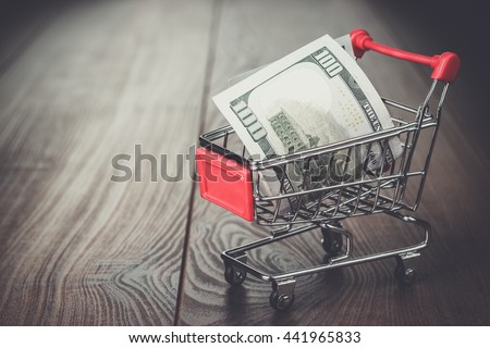 one hundred dollars in the shopping trolley