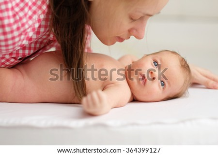 One month old newborn baby with his mother