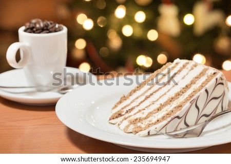 one slice of cake served on the plate, decorated with whipped cream and cafe mug