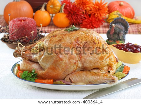 One whole roasted turkey in a festive Thanksgiving setting.
