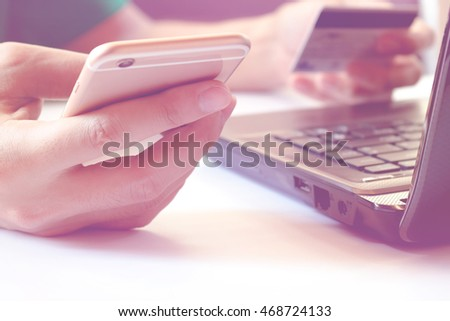 Online payment,Man using laptop and pay by credit card, hands holding smart phone using credit card for online shopping