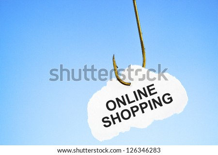 Online Shopping on a fishing hook in front of blue computer monitor. Conceptual image about the risk of addiction to online shopping.