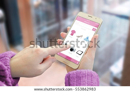 Online shopping with smart phone. Woman use shop web site to buy red shoes. Business center in background.