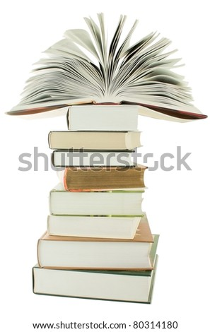 Open book on the stack of books isolated on white