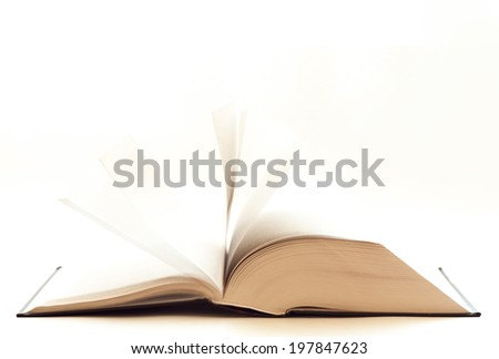open book on the table face down on a white background, flipping pages
