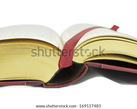Open book with golden side and bookmark against white background