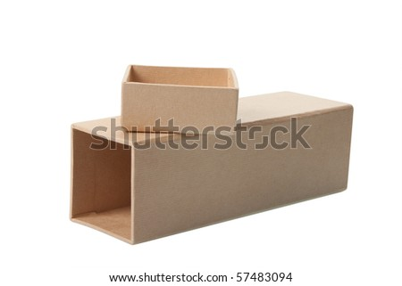 Open cardboard box laying on it's side with separate lid sitting on top, isolated over white background.