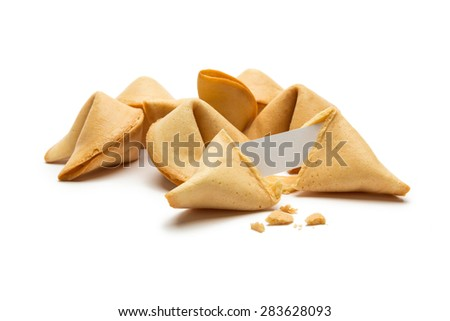 open fortune cookie with crumbs on white background