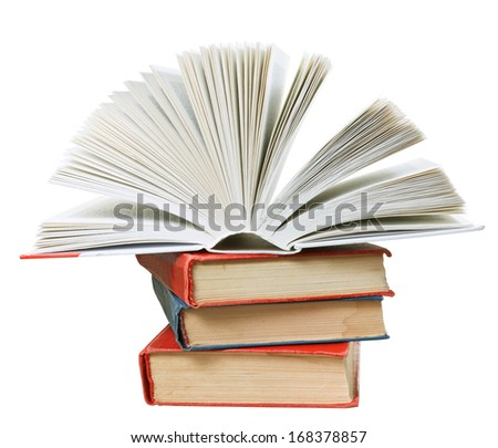 open new book on top of stack of books isolated on white background