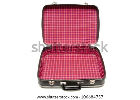 Open vintage suitcase over a white background