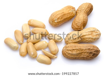 Opened and whole peanuts, isolated on white