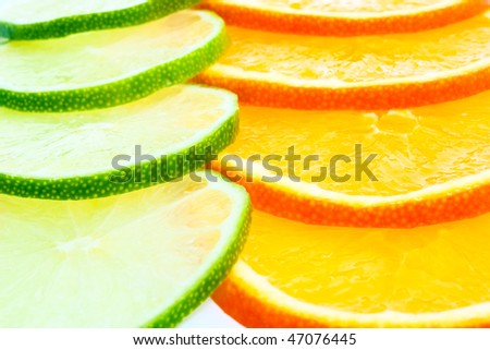 orange and lime pieces close-up background