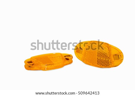 Orange bicycle reflector for wheels isolated on a white background