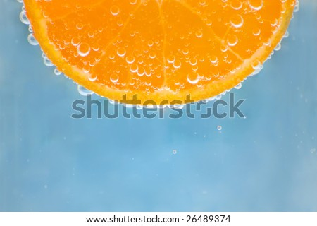 orange in water with bubbles