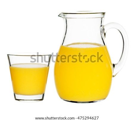 orange juice in a glass and carafe on a white background