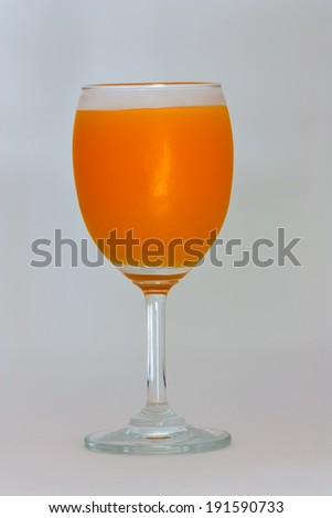 Orange juice in glass on white background.