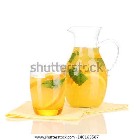 Orange lemonade in pitcher and glass isolated on white