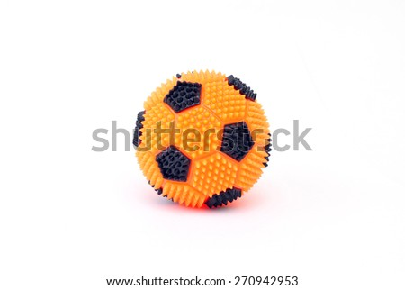 Orange massage ball in the form of a soccer ball isolated on a white background