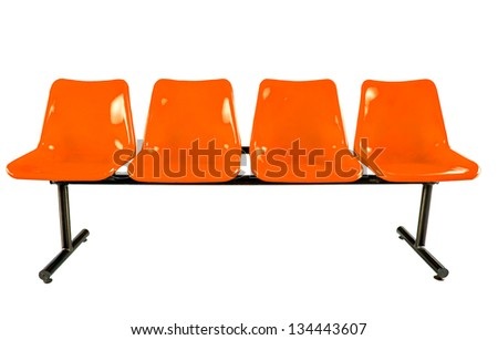 Orange plastic chairs isolated on white background