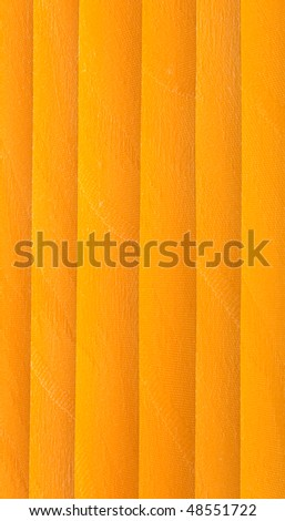 Orange vertical jalousie made of cloth. Background