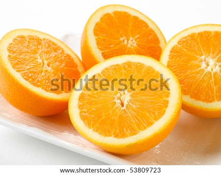 Oranges fresh cut on white plate.