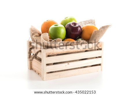 oranges, green and red apples in wooden box