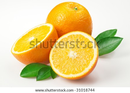 Oranges with leaves on white