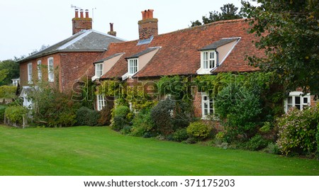 ORFORD, SUFFOLK, ENGLAND - SEPTEMBER 21, 2014: Red brick cottages at Orford Suffolk England.