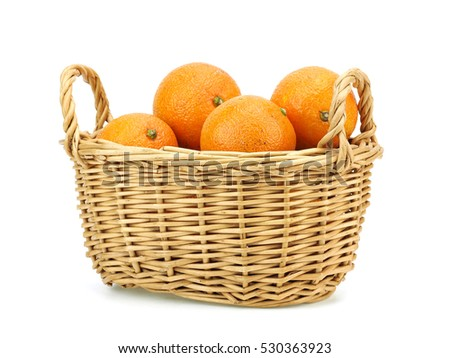 Organic mandarin, tangerine citrus fruits in basket on a white background.