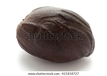 Organic Mature Organic Nutmeg (Myristica fragrans) isolated on white background. Macro closeup Front view.