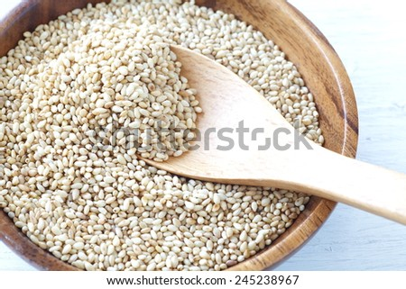 Organic natural sesame seeds on white wood table