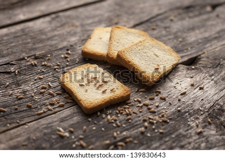 Organic toast bread on a rustic wooden board
